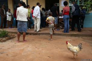 Voters wait in line to cast their vote at a polling station in Antananarivo