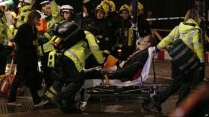 Emergency services tending to a man