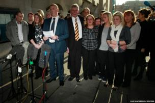 The family of Lee Rigby stand as a police spokesman reads a statement on their behalf outside the Old Bailey in central London