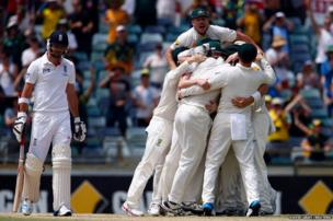 Australia's players celebrate winning the Ashes test cricket series against England