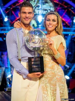 Abbey Clancy and partner Aljaz Skorjanec with their Strictly trophy