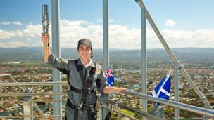 Australian Commonwealth diver Brittany Broben poses with the Queen's Baton at the top of Q1 tower as the relay arrived in Gold Coast, Australia.