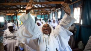 Kenyans pray as they hold a church service for the victims of the Westgate Shopping Centre attack on September 29, 2013
