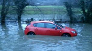 Car stuck in flood