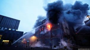 Water jets are sprayed into the back of the former Dobbins Department Store in the Northern Quarter, Manchester.