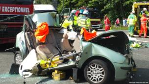 Firefighters attend a car crash on the M56 motorway