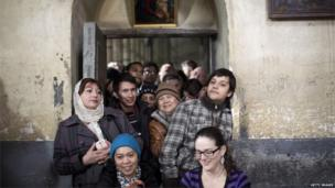 Christian worshippers at the Church of the Nativity in Bethlehem, West Bank, 25 Dec