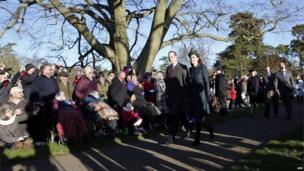 Prince William and his wife Catherine, Duchess of Cambridge, arrive for a traditional Christmas Day Church Service at Sandringham in eastern England, on 25 December 2013.