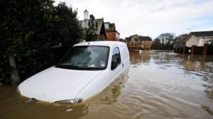 A car submerged near Iford Bridge Home Park