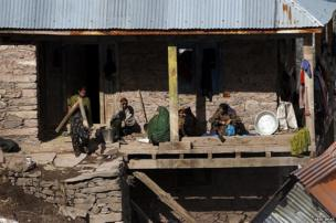 A Kashmiri Muslim family seen outside their home in Chauranda village close to the Line of Control.