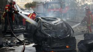 Firemen douse a burning vehicle following a car bomb explosion that rocked central Beirut (December 27, 2013)