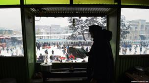 Bismela, 37, fans a small fire as he prepares to start cooking kebabs for customers at a tea house in Kabul