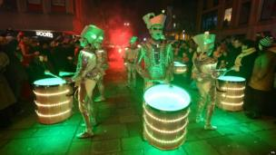 Illuminated drummers at Newcastle's New Year's Eve Winter Carnival