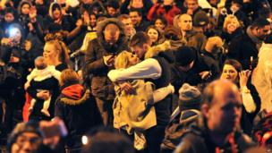 A couple kiss during New Year celebrations in London