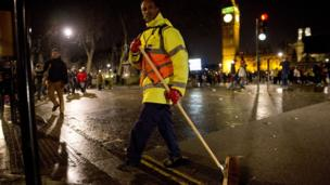 The clean up begins in central London after the New Year celebrations