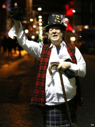 Man celebrates the start of the new year in Edinburgh
