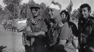 Major General Ariel Sharon with Defence Minister Moshe Dayan (left) on the west bank of the Suez Canal on 18 October 1973