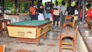 Members of the public view blood stains on the floor at the Tanduri Bar and Night Club in Ukunda which is 40km south of Kenya's coastal town of Mombasa