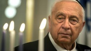 Ariel Sharon in lighting an Hanukkah candle at his office in Jerusalem on 27 December 2005