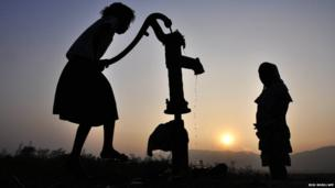 Indian children collect drinking water from a tube well in Morigoan district, India