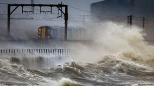 A train passes along the coast at Saltcoats in Scotland