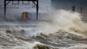 A train passes through the coast at Saltcoats in Scotland