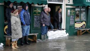 Isle of Man residents on Ramsey harbour after the northern town was flooded on 3 January