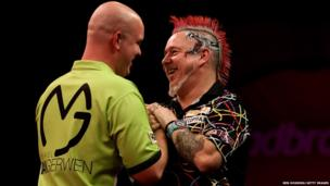 Michael van Gerwen with Peter Wright