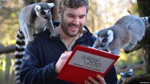 Keeper and lemurs