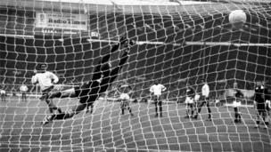 Eusebio (L) hammers his penalty kick past Russia's Lev Yashin, to put his country in the lead during the World Cup third place play-off game at Wembley, 29 July 1966