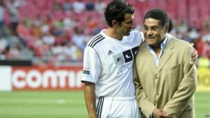 Luis Figo poses with Eusebio at the beginning of a Luis Figo Foundation charity football match at the Luz Stadium in Lisbon, 2012