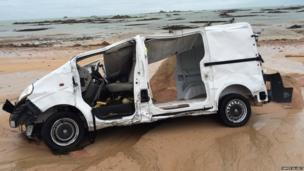 Van washed up on a Jersey beach. Photo: James Allbut