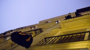 Activists pull up their belongings after occupying an empty building in Madrid, Spain