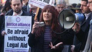 Janis Sharp addresses a demonstration outside Westminster Magistrates Court