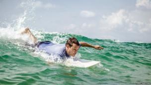 Will Tillet catches a wave off Bureh Beach