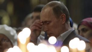 Vladimir Putin praying, January 6, 2014