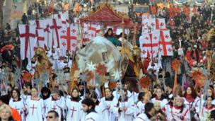 """Participants march on the street during """"Alilo"""", a religious procession, to celebrate the Orthodox Christmas in Tbilisi, January 7"""