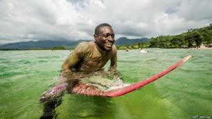 Donald surfing at the Bureh Beach Surf Club