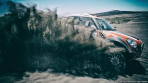 Krzysztof Holowczyc and Konstantin Zhiltsov of Poland drive their Mini on Day two of the Dakar Rally in the Dunes of Nihuil, Argentina