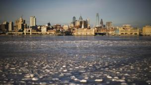Ice collects on the Delaware River in view of Philadelphia