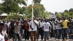 People march in protest about the killing in an ambush of Col Mamadou Ndala, North Kivu, DR Congo - Monday 6 January 2014