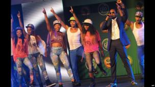 D'Banji (2nd right) performs with dancers in Lagos, Nigeria - Thursday 9 January 2014