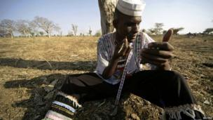 A man from a nomadic group in Blue Nile, Sudan, applies traditional make-up - Monday 6 January 2014
