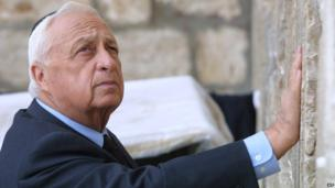 Israeli Prime Minister-elect Ariel Sharon places his hand on the Western Wall in 2001