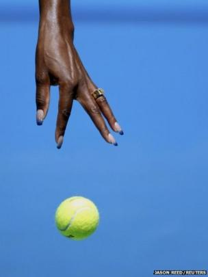 Blue-tipped fingernails of US tennis player Venus Williams