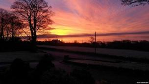 Sean Crumish took this picture showing the sun rising over Binevenagah, County Londonderry