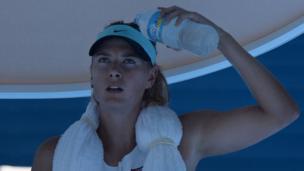 Russia's Maria Sharapova cools off