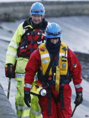 Coastguard officer searches the shoreline near Cramond