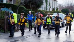 Members of a mountain rescue team join search