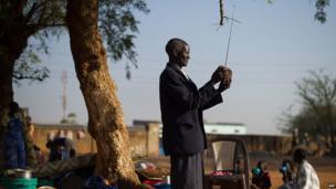 A man tuning his radio in Juba, South Sudan - Monday 13 January 2014